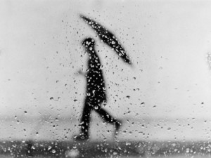 h-armstrong-roberts-silhouette-of-man-carrying-an-umbrella-walking-in-the-rain